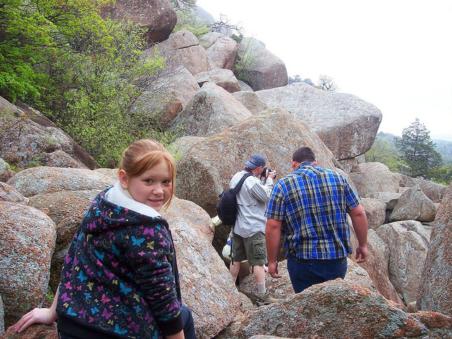 A young hiker tackles a rock scramble along the Charon's Garden Trail in Wichita Mountains National Wildlife Refuge in Oklahoma. Refuges offer outstanding fall hiking, from mild to strenuous. Photo: David Smith