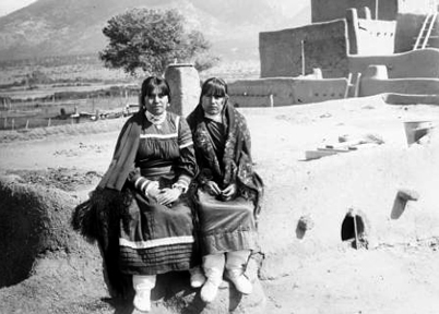Taos Pueblo. Two residents of Taos c. 1890.  Despite general resistance to outside infiltration, Spanish cultural influence in architecture, practice and garb are seen throughout the Pueblo. Courtesy of the Library of Congress